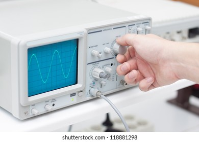 Working with oscilloscope in laboratory