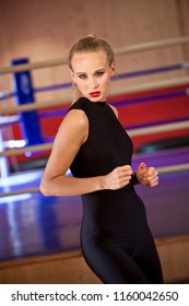 Working out model in catsuit in gymnastic studio