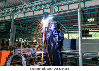 Working person About welder steel Using electric welding machine There are lines of light coming out. Concept safety equipment.