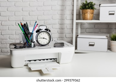 Working place of a business person. Printer, computer and other office supplies