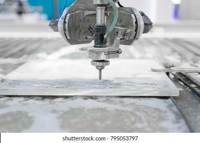 Working process cutter parts by waterjet cutting machine in workshop