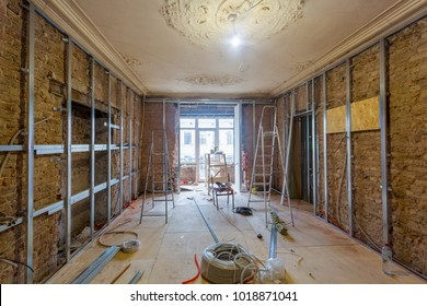 Working process of installing metal frames for plasterboard (drywall) for making gypsum walls  in apartment is under construction, remodeling, renovation, extension, restoration, reconstruction