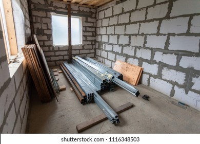 Working process of installing metal frames for plasterboard drywall for making gypsum walls in apartment is under construction, remodeling, renovation, extension, restoration and reconstruction