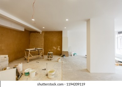 Working process of installing metal frames for plasterboard -drywall - for making gypsum walls in apartment is under construction, remodeling, renovation, extension, restoration and reconstruction.