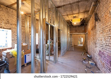 Working process of installing plasterboard or drywall for making gypsum walls in apartment is under construction, remodeling, renovation, extension, restoration and reconstruction. Concept of home
