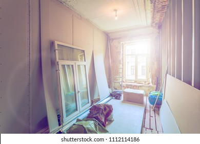 Working process of installing pvc windows and metal frames for plasterboard  -drywall - for making gypsum walls in room of apartment is under construction, remodeling, renovation, extensio