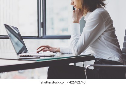 Working Process in Modern Office. Young Woman Account Manager Working at Wood Table with New Business Project. Typing keyboard,Using Contemporary Laptop. Horizontal. Film effect. Blurred background.