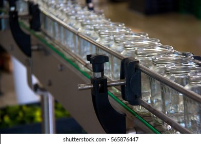 Working process of the production of cucumbers on cannery. Packaging line for processing cucumbers into glass can.