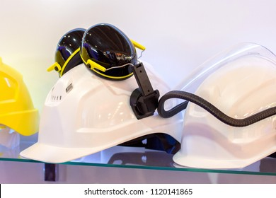 Working professional helmets to protect builders with headphones and a headlamp