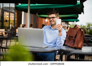 working remote. handsome young man, blogger or remote working, with laptop at terrace outside