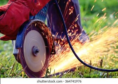 working saw sparks