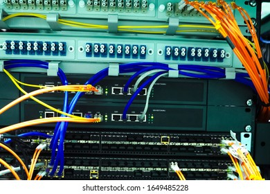 A working server. Internet wires and flashing lights on the server.