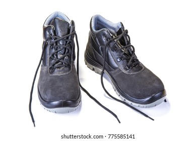 Working shoes with steel plate to protect toes on white