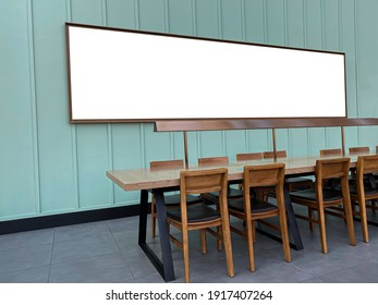 Working space area with long table ,chair made from wooden and big blank frame picture for text or copy space.