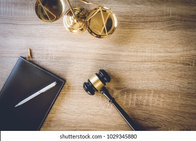 working space of lawyer with law gavel ,laptop ,legal book and brass scale of judge. lawyer and law ,judiciary and legislature courtroom legal concept. top view flatlay lawyer background.