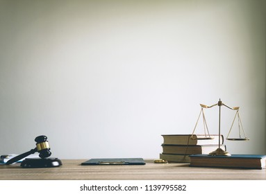 working space of lawyer with law gavel ,legal book and brass scale of judge. lawyer and law ,judiciary and legislature courtroom legal concept. top view flatlay lawyer background.