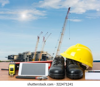 Working table engineer with tablet and tools in building construction crane
