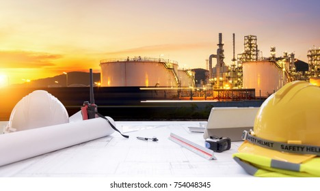 Working table engineer with tablet and tools in oil refinery industry business plant.