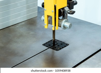 Working table of a vertical band saw. Modern woodworking equipment.