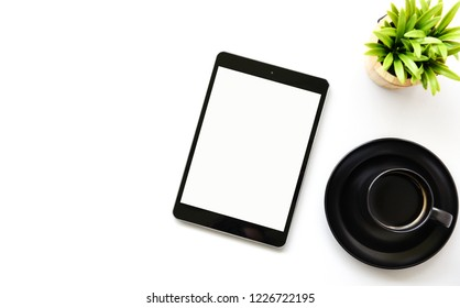 Working with tablet computer,Hot coffee and cactus copy space table background.Top view,Flat lay,style Minmal workspace,business Concept