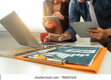 Working team meeting concept,businessman using smart phone and laptop and digital tablet computer in modern office with virtual interface icons network diagram at modern office in morning light