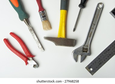 Working tools - a hammer, a brush, a screw-driver and others