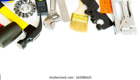 Working tools. Many working tools - hammer, ruler, spanner and others on white background.