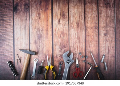 working tools on dark wood background with space for text