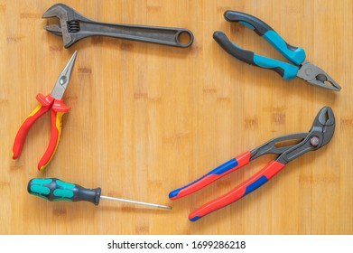 Working tools on wooden rustic background. top view.