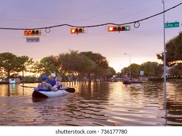 Working traffic lights over flooded Houston streets and boats with people at sunset. Texas, USA