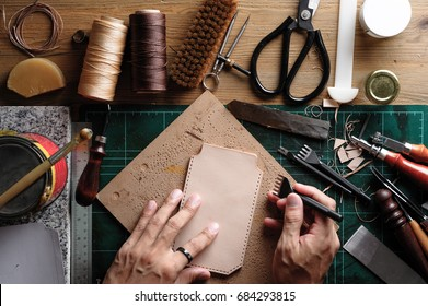Working with vegetable tanned leather. Leather and the craft tools.