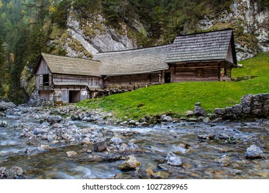 Working watermill with flowing water mountain stream in the village