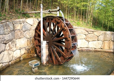 Working watermill wheel with falling water in south korea.