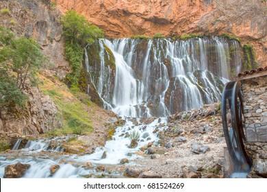 Working watermill wheel with falling water - Kapuzbasi waterfall, Kayseri Turkey