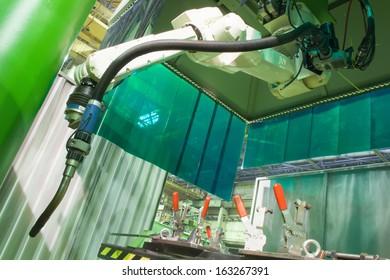 Working welding robot in factory