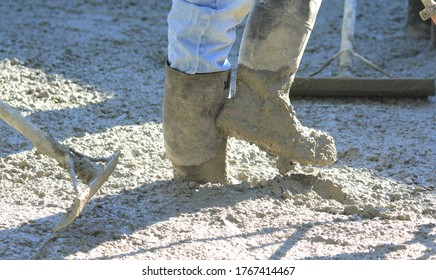 working with wet concrete while paving a driveway