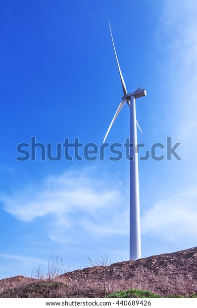 working windmill and blue sky