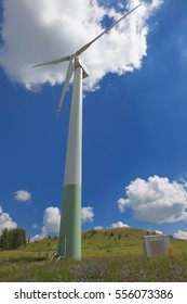 Working the wind-power generator on the sky background with clouds