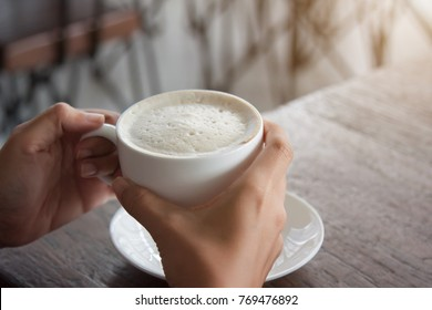 Working Woman drinking hot coffee in the morning.