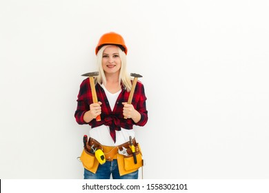 working woman in helmet with tools