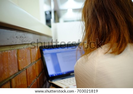 Working woman with laptop in University