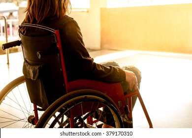 working woman on wheelchair in hospital, warm filter