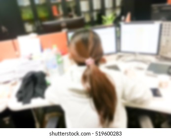 Working women blur in the workplace. Abstract blur background table work in office with computer. Shallow depth of focus about stationary in office.