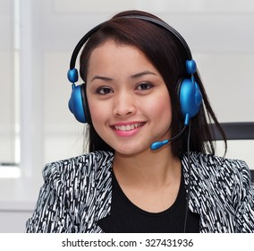 A working young lady with telephone