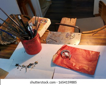 Workingplace of a jewelry designer in his workshop with tools and silver jewelry in Santiago de Compostela in Spain