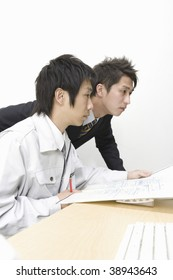 Workman and businessman checking the design