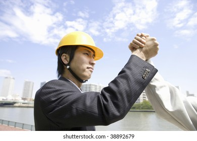 Workman and Businessman shaking hands