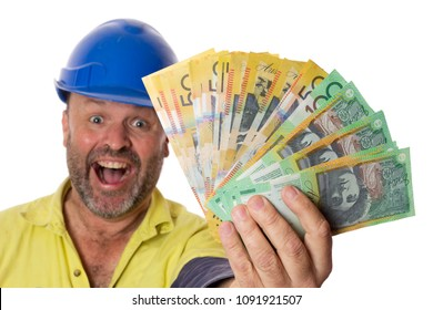 A workman excitedly showing a wad of cash.