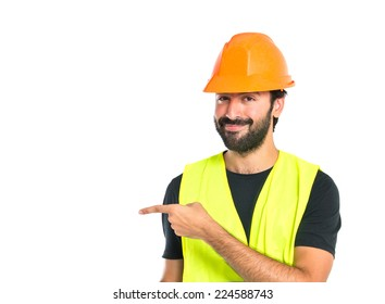Workman pointing to the latertal over white background