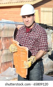 Workman with tiles